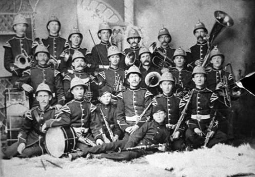 The 32nd Battalion Band (circa 1886) wearing four-panel American sun helmets