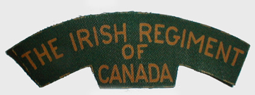Printed shoulder title for the Irish Regiment of Canada. Cut guide lines are clearly visible around the edge. Bill Alexander