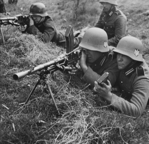 Note the use of British weapons. Here they are shown using a BREN gun.