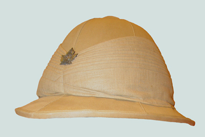 A khaki Wolesley helmet with an extravagant pugaree and the badge of the 38th Battalion, later the Cameron Highlanders of Ottawa.