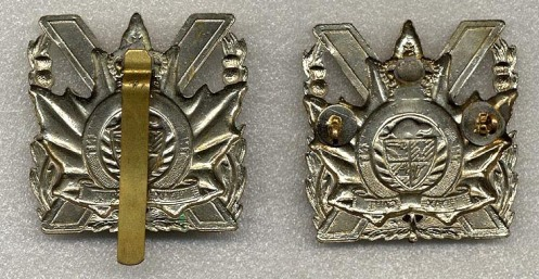 1959 Pattern Cap badge with original slider and later example with lugs added