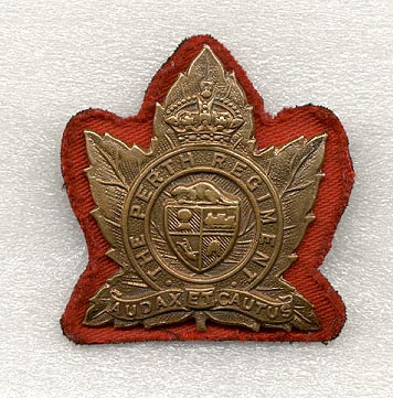 One other alteration that was commonly done towards the end of the war was to wear a coloured cloth backing behind the badge. There is some debate as to which colour was to be worn. The above example made from a canvas 1st div distinguishing patch clearly shows that red was one of the colours worn. Red was the colour authorized for wear by infantry units. Several veterans of the unit also suggested that they wore maroon backings behind their badges to represent the 5th Armoured Division.