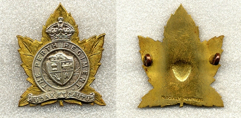 A three piece Scully made badge. Also using lugs, this version has the coat of arms as a separate 3rd piece. The depression in the centre of the badge is a result of the manufacturing process. It is stamped W Scully Montreal at the bottom of the badge.