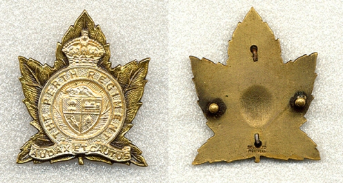 The Scully made officers' badge is significantly different from the preceding patterns. Instead of using lugs, this badge has screw posts as a means of attaching the badge to headdress. It is a two piece badge with a frosted silver overlay attached to an antiqued brass/gilt leaf. It is stamped Scully Ltd Montreal at the bottom of the badge.