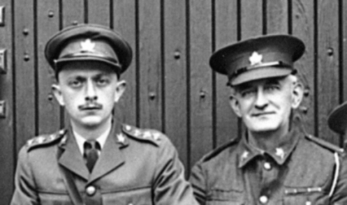 An officer and NCO showing the location of collar badges circa 1930