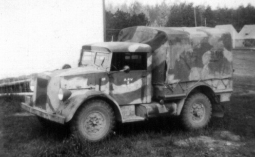 The Canadian Armoured Fighting Vehicle School, at Camp Borden, Ontario, was the only Canadian home-based unit to apply a camouflage scheme to their vehicles, circa 1940. This example exhibits the full canvas cover provided for vehicles destined for general duties only, artillery tractors did not included these. MilArt photo archives