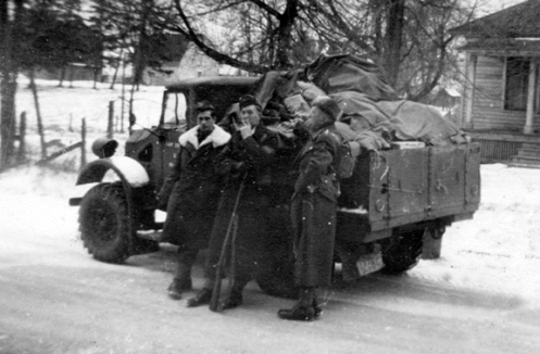 One of the 50 Ford 15-cwt trucks contracted for in 1939 and delivered in early 1940. Photo courtesy Colin Stevens whose father, Lt. Stevens, is shown standing on the far right.
