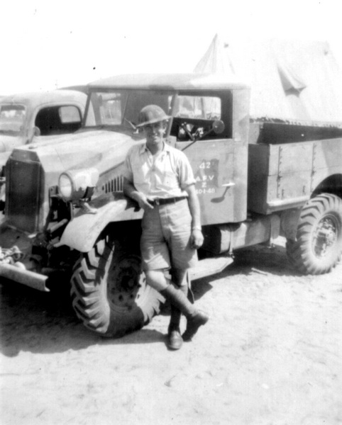 A soldier's souvenir photo displays the 1940 Ford in a camouflage pattern. The door markings identify this as the Armoured Fighting Vehicle School at Camp Borden, Ontario. MilArt photo archives