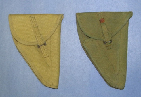 Two variants of the first pattern holster, left, the tan-coloured original featuring the original quick-relase tab. Right, a green example showing the second pattern of release tab. Ed Storey collection