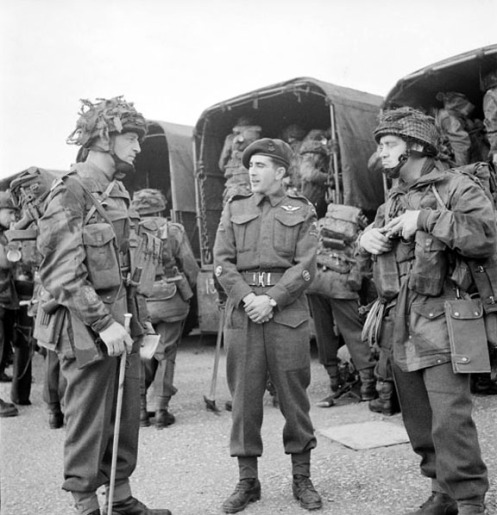 Can Para June 44 e002852749 v6.jpg Preparing for their Normandy descent, these soldiers wear Helmets, Steel, Airborne Troops Mk.I heavily covered with netting and scrim.
