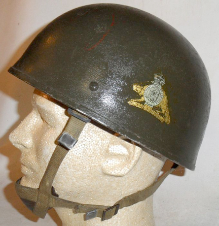 This 1953-dated British airborne helmet has received a coat of Paint, Exterior, Flat Green No 3-213.and has a Van Doos decal on the left side. Author's collection