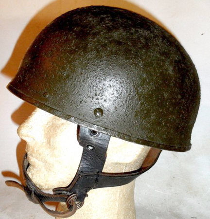An example of a Canadian-made steel DR helmet converted to an airborne helmet. It has been painted Paint, Exterior, Flat Green No 3-213. Author's collection
