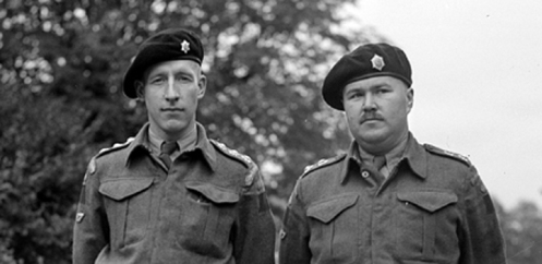Two GGFG officers. As Officers did not wear collar badges in Service Dress, and the GGFG had no authorized beret badge at this time, the officer on the left has taken a Senior NCO's collar badge into use.