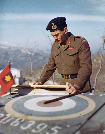 Note the use of the Division's Garnet-coloured formation patch (with the addition of a gold maple leaf) by Maj-Gen Simmonds, GOC 5 Cdn Armoured Division, in Italy