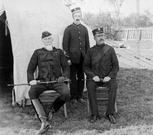 The Commanding Officer, Adjutant and an orderly, ca.1892. Note the Torin cap worn by the Colonel and the two styles of forage cap, bot OR and Officer, worn here. Of interest is the tunic worn by the orderly. Due to limited funds, Militia & Defence could not afford to purchase Guards pattern tunics and provided a quantity of Infantry patern tunics. Some of these were later adapted to double-buttons although the (incorrect) cuffs remained unaltered. MilArt photo archives.
