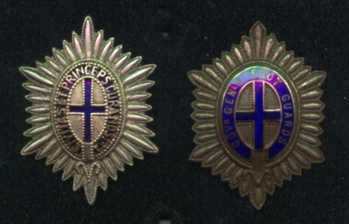 Two patterns of the Officers' badge. On the right a variant of the badge with Regimental title and on the left a pierced example exhibiting the Regimental motto. Author's collection