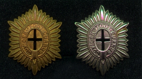 The brass badge appears to have been used prior to the First World Ward and into the 1920s when it was suplanted by the white metal badge. Pre-war only Sergents and Warrant Officers had a pierced cross although postwar all ranks wore the same badge.