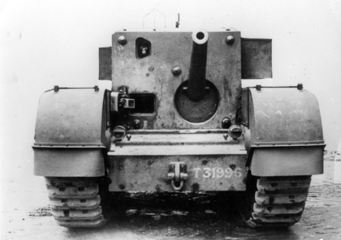 An image of the Carrier, Churchill, 3-inch Gun Mk I, showing the front of the large fixed box-type superstructure, that replaced the turret. Note the open aperture in the left upper corner of the front plate directly above the driver's aperture, for the No. 33 sighting telescope and the location of the 3-inch, 20-hundredweight high velocity anti-aircraft gun, in the front plate. Also visible, on the turret roof to the right of the open aperture for the No. 33 sighting telescope, is the external triple-vane sight that was provided for the crew commander, so that he could bring the driver into rough alignment with the target. Source: author's collection.