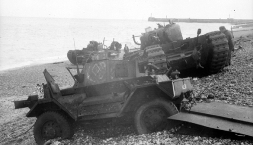 "In the centre of this photo from Dieppe, is T68875 Beetle, a Churchill Mk II (Special) of No. 8 Troop, ""B"" Squadron, The Calgary Regiment, which was fitted with the Oke flame-throwing system. As can be seen, the flame projector was mounted in the front of the tank on the left of the hull gunner's position and protruded out between the hull machine gun and the left front horn of the tank, the muzzle of which can be seen sticking up above the left track. The tank to the right rear of Beetle, on the shoreline, is T68881 Ringer, a Churchill Mk II, of Regimental Headquarters, The Calgary Regiment. Source: Authors' collection."