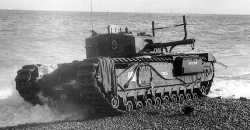 "T31655 Buttercup, a Churchill Mk III of No. 9 Troop ""B"" Squadron, The Calgary Regiment, commanded by Sergeant J.D. Morrison, also one of five Churchill tanks of the regiment that was fitted with the ""Beach Track Laying Device,"" for the Dieppe raid. Having successfully landed and laid its chespaling and, having crossed the beach, wire, and seawall, it successfully jettisoned its beach track laying device, whereupon it engaged enemy targets on the west headland and in seafront buildings to the west of the Casino. Later, it returned to the beach below the Casino, where it took up a position on the water's edge. It could not be destroyed by its crew prior to their withdrawal, due to the number of infantry wounded who had sought shelter from enemy fire on its seaward side. Note that there are no remnants of the beach track laying device, on her front, it having been jettisoned successfully. Source: Authors' collection."