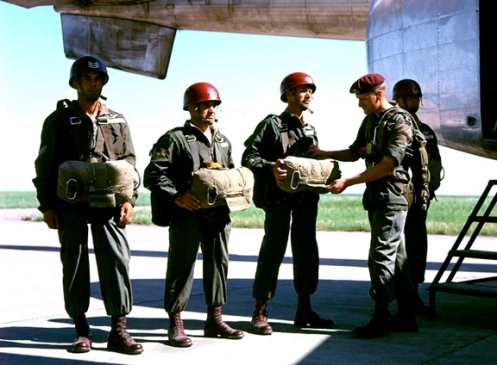 This picture, taken in 1956, shows jump instructor wearing red helmets, with rank insignia.