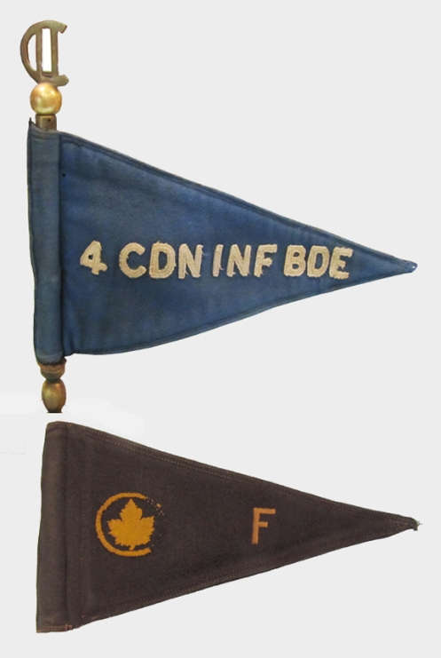 """Brigadier J. E. Sager's pennants. The top example was used when he commanded the  4th Canadian Infantry Brigade. This pennant has been adapted to a desk ornament and exhibits a locally-produced staff featuring the C/2 symbol of the 2nd Canadian Infantry Division.  The lower pennant was used when he commanded """"F"""" Reinforcement Group. Courtesy Royal Westminster Regiment Museum"""