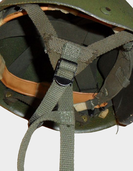 A close-up of the modified strap attachments on a Canadian-modified M1 Parachutist's Helmet.