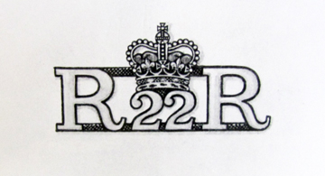 This drawing, from the Royal Warrant, shows the badge worn since 1958 and still in wear today.