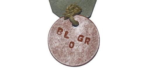 Rear view of Pte Little's red disc. The inclusion of a blood group is unusual.