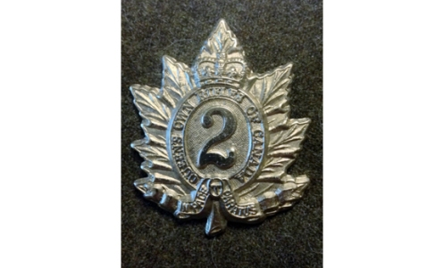 QOR cap badge 1940 made of white metal – Graham Humphrey Collection