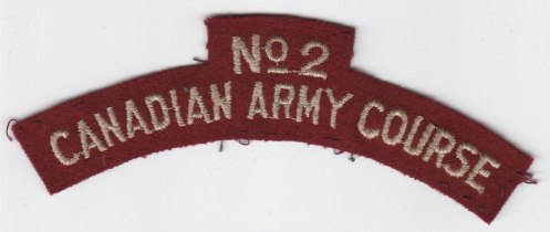 Embroidered No 2 CAUC titles. Chain link stitch oyster on green, silver on maroon. Universities not identified