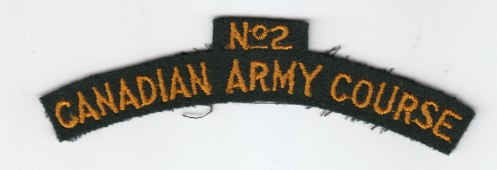 Embroidered No 2 CAUC titles. Top, scarlet embroidery on yellow. University not identified. Bottom title. This pattern, in yellow on dark green has been identified as the generic No 2 course title.