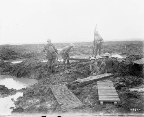 Canadian Pioneers laying trench mats over mud. Battle of Passchendaele.