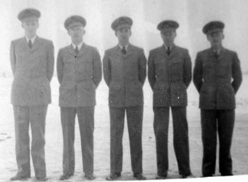 Opening day at #9 EFTS with Instructor Charlie Harrod in the middle. Cam Harrod collection Note that the uniforms lack any insignia as they were not designed yet
