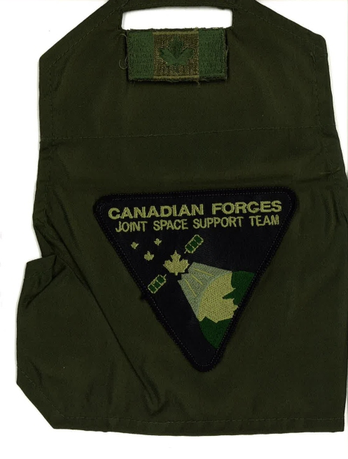 The brassard worn with the subdued badge by team members when on Ops and in CadPat. When the team switched to flight suits the badge was changed to a pattern with Velcro backing. Author's collection
