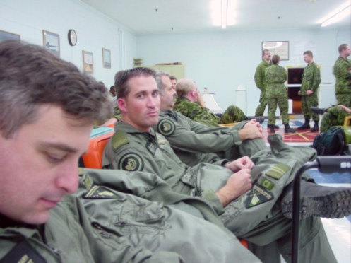 Team members attend a briefing. The subdued pattern is shown in wear. Author's collection
