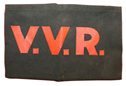 The basic VVR armband, manufactured by the Northwestern Manufacturing Co., and featuring a sinmple black cotton band with silk-screened lettering. The armband is joined by two elastic bands at the rear. Courtesy Marway Militaria