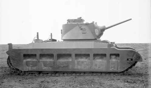 A right-side view of the pilot model Infantry Tank Mark II, Matilda II (A12), A12EA1, while undergoing trails at the British Mechanization Experimental Establishment. A12EA1, was powered by twin commercial AEC straight six-cylinder water-cooled diesel engines, making the Infantry Tank Mark II, Matilda II (A12), the first British tank in service to use diesel engines. Source: IWM (KID 1542).