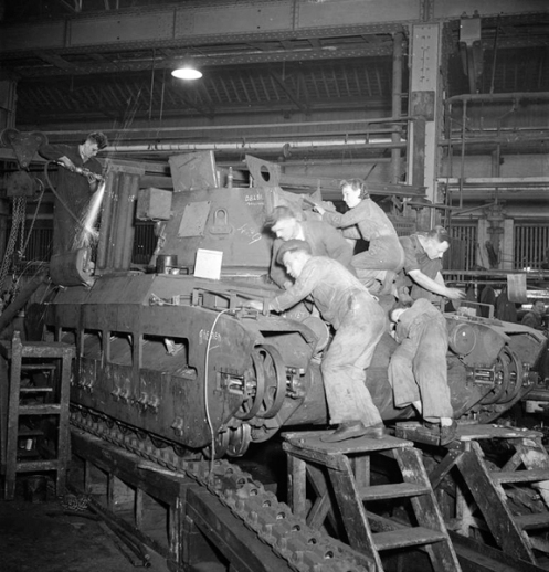 Work is finished off on a Matilda tank, at a factory somewhere in the United Kingdom. Note the grinding down of rough surfaces, which is being done by a worker on the rear deck. Source: IWM (D 9191).