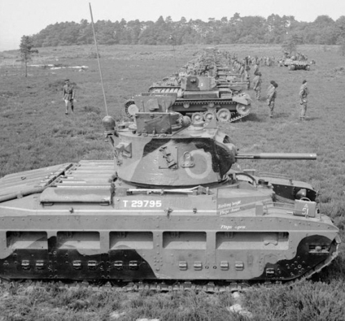 In the foreground is a Mark IIA* Matilda III Close Support, armed with the 3-inch howitzer (with the co-axial 7.92-millimetre Besa machine gun mounted on it's right). Although this particular tank (T29795) did not serve with the Canadian Army Overseas, the Mark IIA* Matilda III Close Support tanks that were issued to the Calgary, and Three Rivers Regiments, respectively, would have appeared as such. Source: IWM (H 11654).