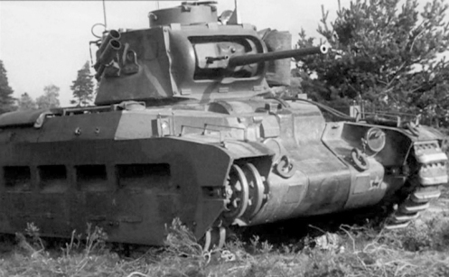 On 4 November 1941, the Calgary Regiment was detailed to send a Mark IIA* Matilda III tank, to Grayshott, Hampshire, to have various pictures taken for the British War Office. While involved in this task, this unidentified tank suffered a track breakage, to the delight of the photographers. The marking, which appears on the lower-left corner of the nose plate, is the formation marking, that was used to identify vehicles of the 1st Canadian Army Tank Brigade, at this time. This formation sign was a gold or yellow maple leaf centred on a black background square, with a black left-facing image of a ram superimposed centrally on the maple leaf. Source: authors' collection.
