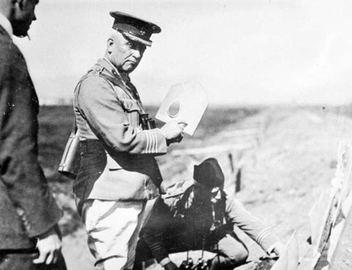 Sir Samuel Hughes holding a MacAdam Shield Shovel.  PA-202396