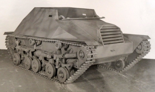 Three-quarter front view of the Tracked Jeep prototype, note the prominent front radiator. No.1 Proving Ground technicians assisted by Victoria Foundry, located in Hull, Quebec, essentially handcrafted the prototype. The original prototype of the Tracked Jeep (or Bantam Armoured Tracked Vehicle)  was assembled at No. 1 Proving Ground in the latter half of 1942. The photographs of this prototype were taken on 7 May 1943.