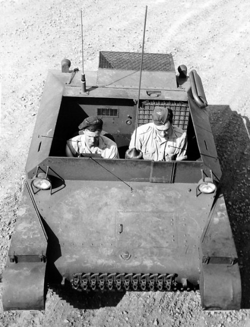 Three-quarter top front view showing driver and gunner in position and driver's periscope.
