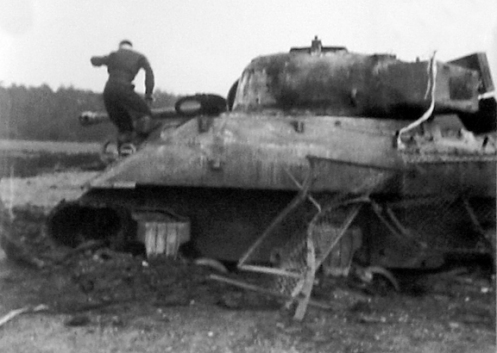 Here the Panzerfaust has struck low, blowing off the screen and penetrating the hull