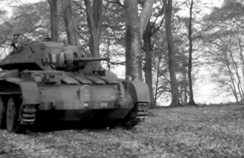 Another view of T18368, while taking part in the filming of  'Ten Tips for Tackling Tanks.' The 'F2,' in the centre of the nose plate, directly below the headlamp, indicates, that this tank is the number two tank of the 'Fighting Group' (commonly referred to as the 'Fighting Troop') of the brigade headquarters, with the other three tanks bearing the markings 'F1,' 'F3,' and 'F4,' respectively. To the left of the 'F2' marking, can be seen the Arm of Service marking ('171') of the brigade headquarters, as explained earlier. The marking that appears above left, of the Arm of Service marking, is that of the Formation sign (by which the formation that the unit operating the vehicle belonged to, was identified), used by the 1st Canadian Army Tank Brigade, from mid August 1941 to mid October 1942, which consisted of a gold or yellow maple leaf centred on an eight-inch by ten-inch square black background, with a black left-facing image of a ram superimposed centrally on the maple leaf. Source: authors' collection.