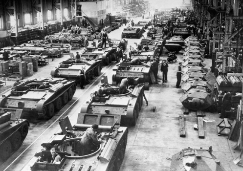 A general view of Covenanter tanks at various stages of production on the assembly line of a factory, somewhere in the United Kingdom, 1941. Source: IWM (P 174).