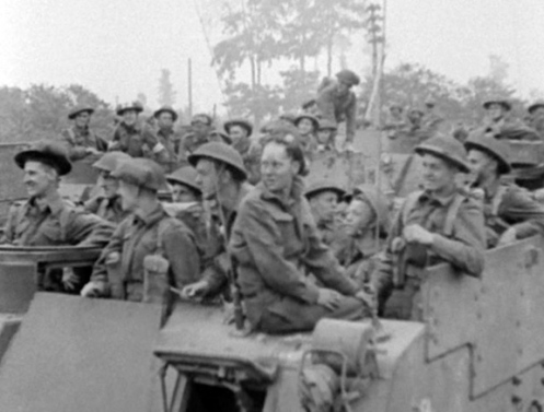 'Priest' Kangaroo armoured personnel carriers, with troops of the 4th Canadian Infantry Brigade, 2nd Canadian Infantry Division aboard, on the evening of 7 August 1944, prior to the launch of Operation TOTALIZE. Note the driver's vision aperture in the open position, with the driver seated above on the top of the upper front plate. Source: 1 CACR Association & Archive.