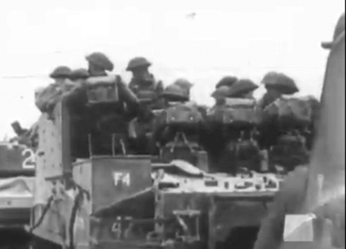 "A rear view of troops 'embussed' (loaded) in a 'Priest' Kangaroo. Note the thickness of the upper left-side additional armour plating, and the 'absence' of the basic pioneer tools, except for a lone shovel, on the engine compartment top plates. This particular vehicle, saw service as the No. 4 gun, ""F"" Troop, 43rd Field Battery, 12th Canadian Field Regiment, Royal Canadian Artillery, of the 3rd Canadian Infantry Division, before conversion to that of a 'Priest' Kangaroo armoured personnel carrier. Source: 1 CACR Association & Archive."