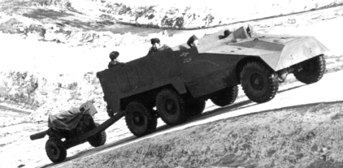 This is the second vehicle built and one of two sent overseas for testing. Here it takes part in trials to find a suitable tractor for the 6-pdr anti-tank gun. Here it is shown negotiating the long ascent - a trial segment it ultimately failed. MilArt photo archives